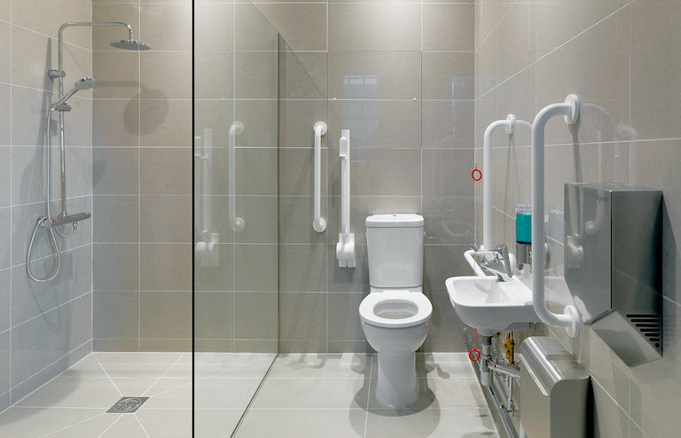 It has access to a disabled toilet, a magnetic glass board for writing, and a large screen TV.